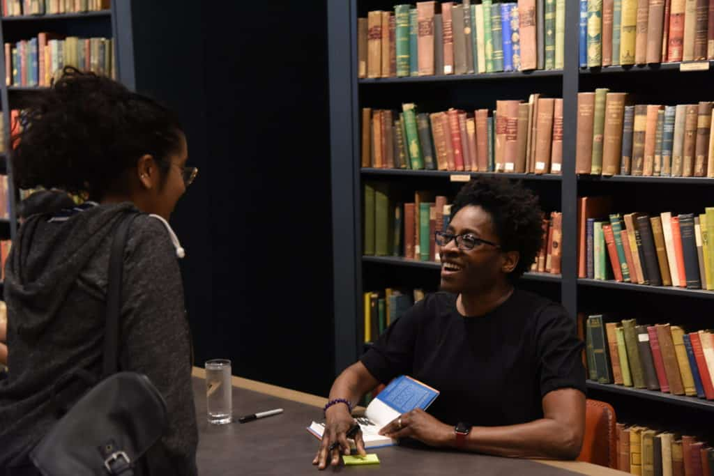 Jacqueline Woodson with kid signing